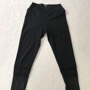 Splits59 Black Leggings with mesh stripes.